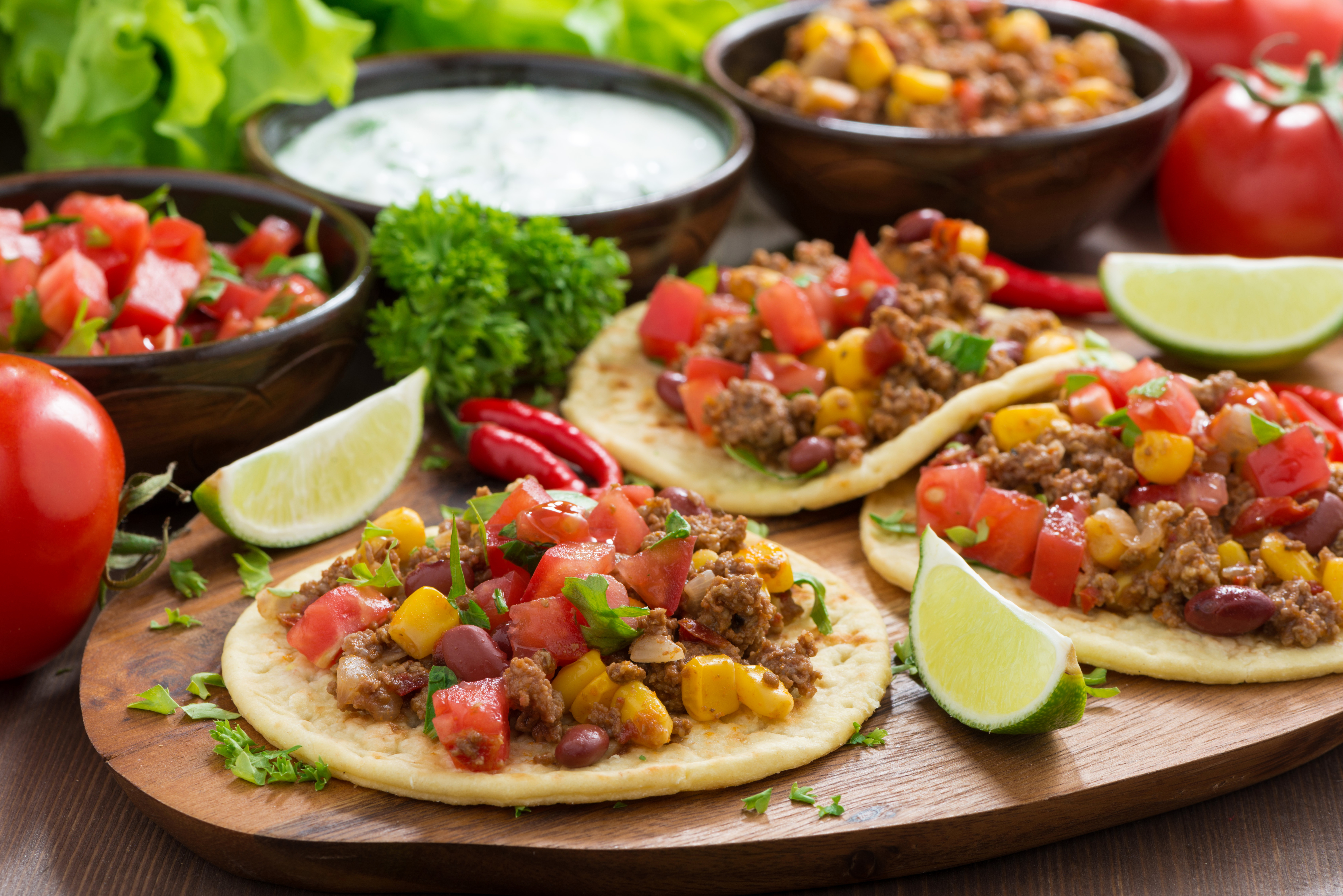 Mexican cuisine – tortillas with chili con carne, tomato salsa